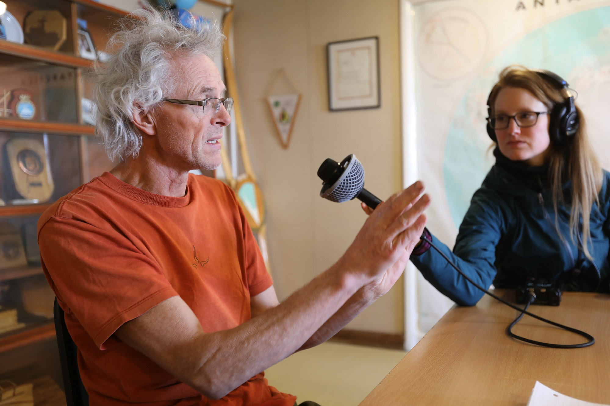 Researcher Andy Smith speaks with journalist Carolyn Beeler at Rothera Station. Photo credit: Linda Welzenbach