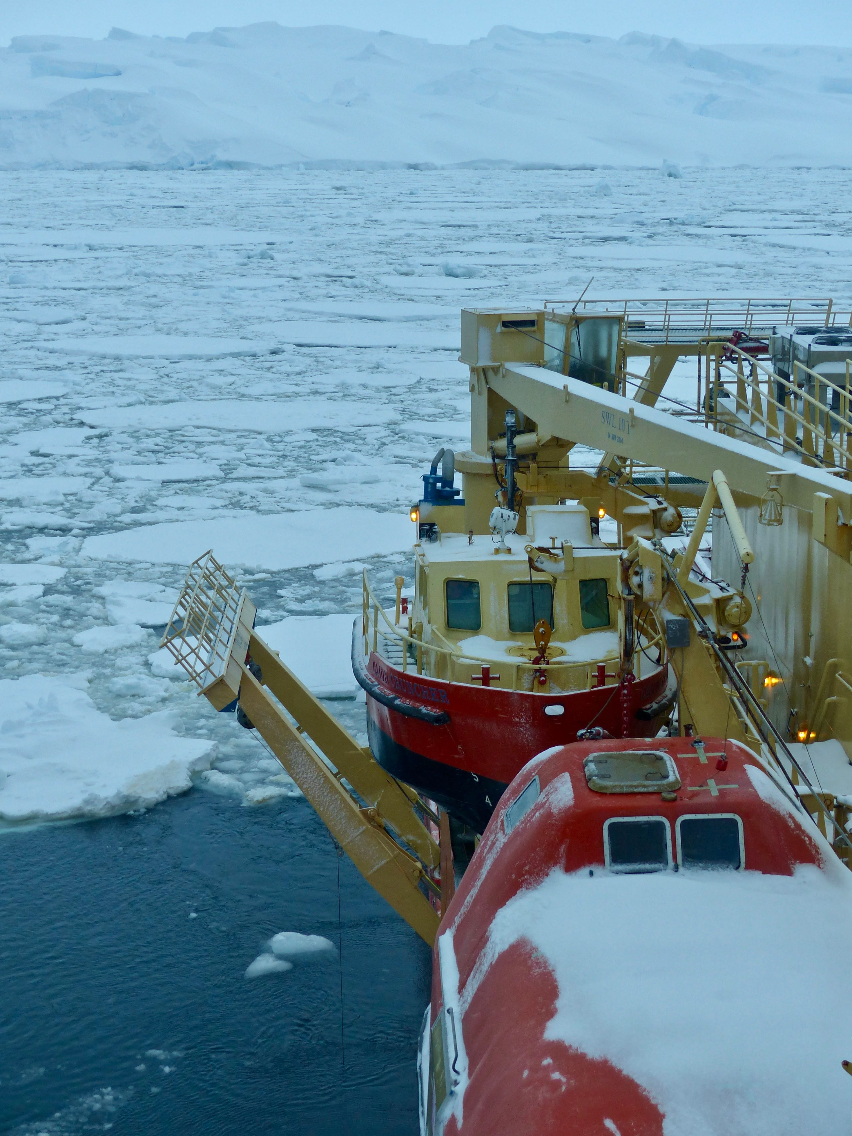 The Palmer sits a short distance from a giant iceberg and Thwaites ice shelf within sea ice that has moved here in the last few hours, beginning the ship's retrieval of the Hugin. Photo credit: Tasha Snow