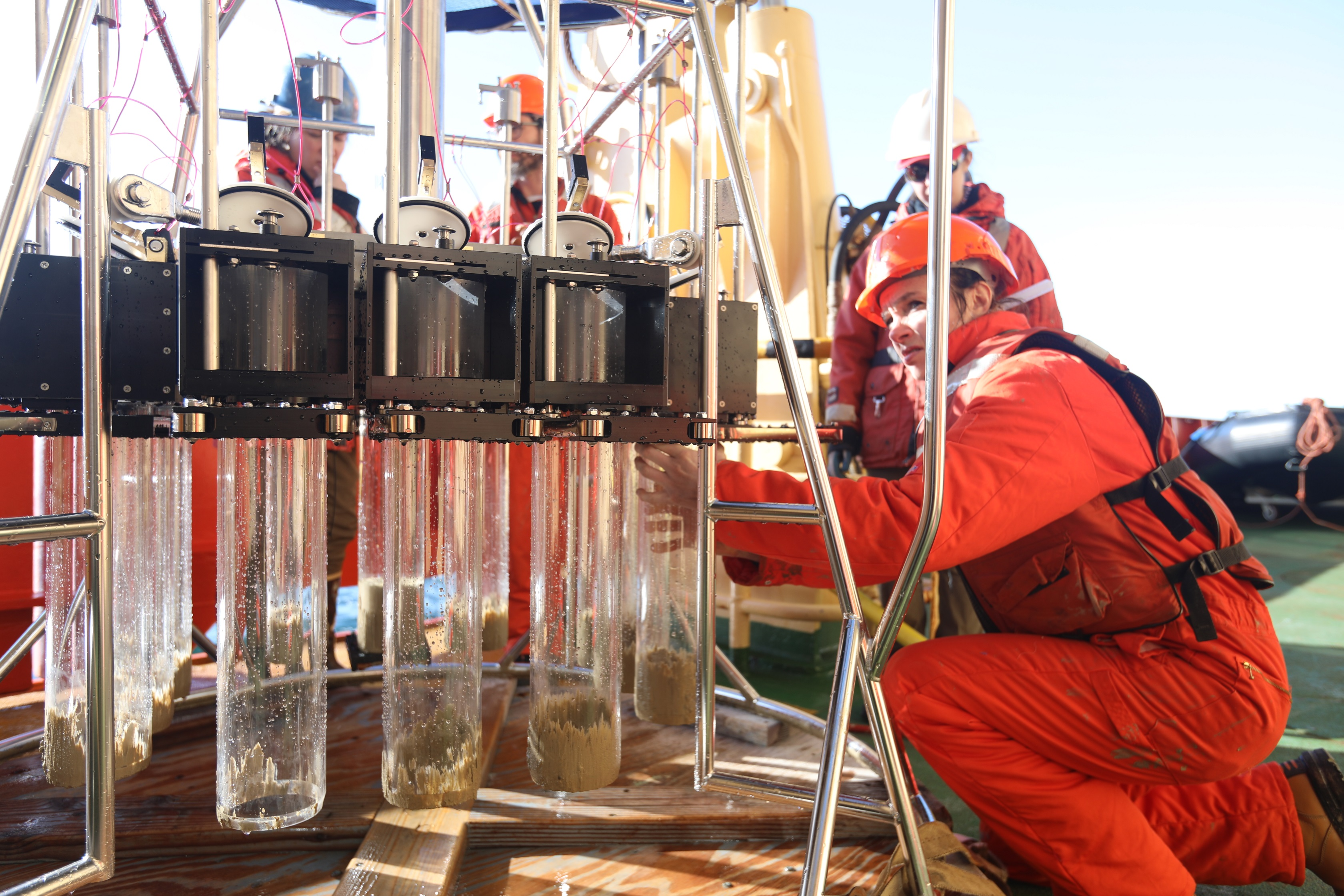 Kelly Hogan with sediment corer onboard the Nathaniel B. Palmer. Credit: Linda Welzenbach