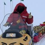 scientist on snowmobile pulling equipment