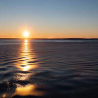 Grease ice dampens ripples in the water near sunset over the Amundsen Sea. Photo credit: Carolyn Beeler/The World