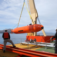 Crew raise the HUGIN autonomous underwater vehicle onto the desk of the N. B. Palmer after a successful deployment. Photo credit: Linda Welzenbach